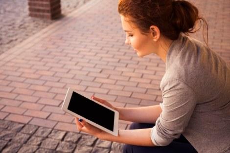 girl watching ipad tablet