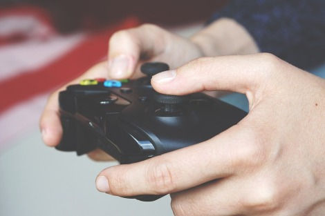 person gaming controller stock photo pixabay