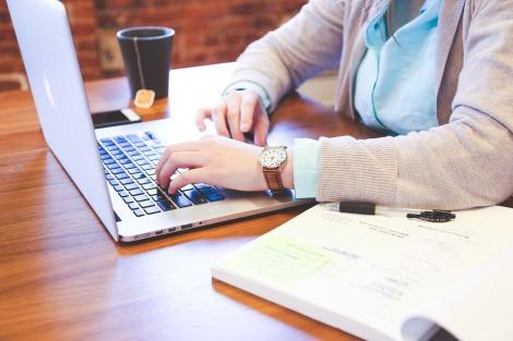 stock photo writer typing macbook laptop casual