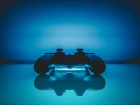 reflection-pad-gaming-gamepad controller stock photo pexels