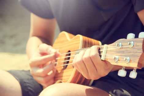 man ukulele string instrument stock photo