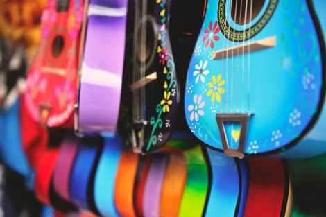 colorful decorative acoustic guitars pexels stock photo