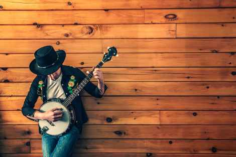 man-person-wall-music-banjo-music-performance stock image pexels