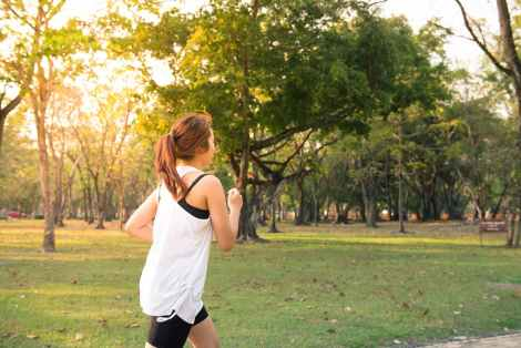 woman running outdoor activity exercise physical fitness stock photo