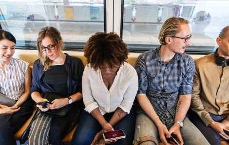 woman holding phone subway stock photo pexels